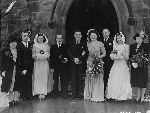 Clarence Blackham and a wedding group