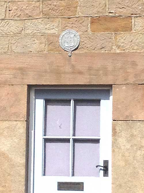 Foresters plaque above a house door